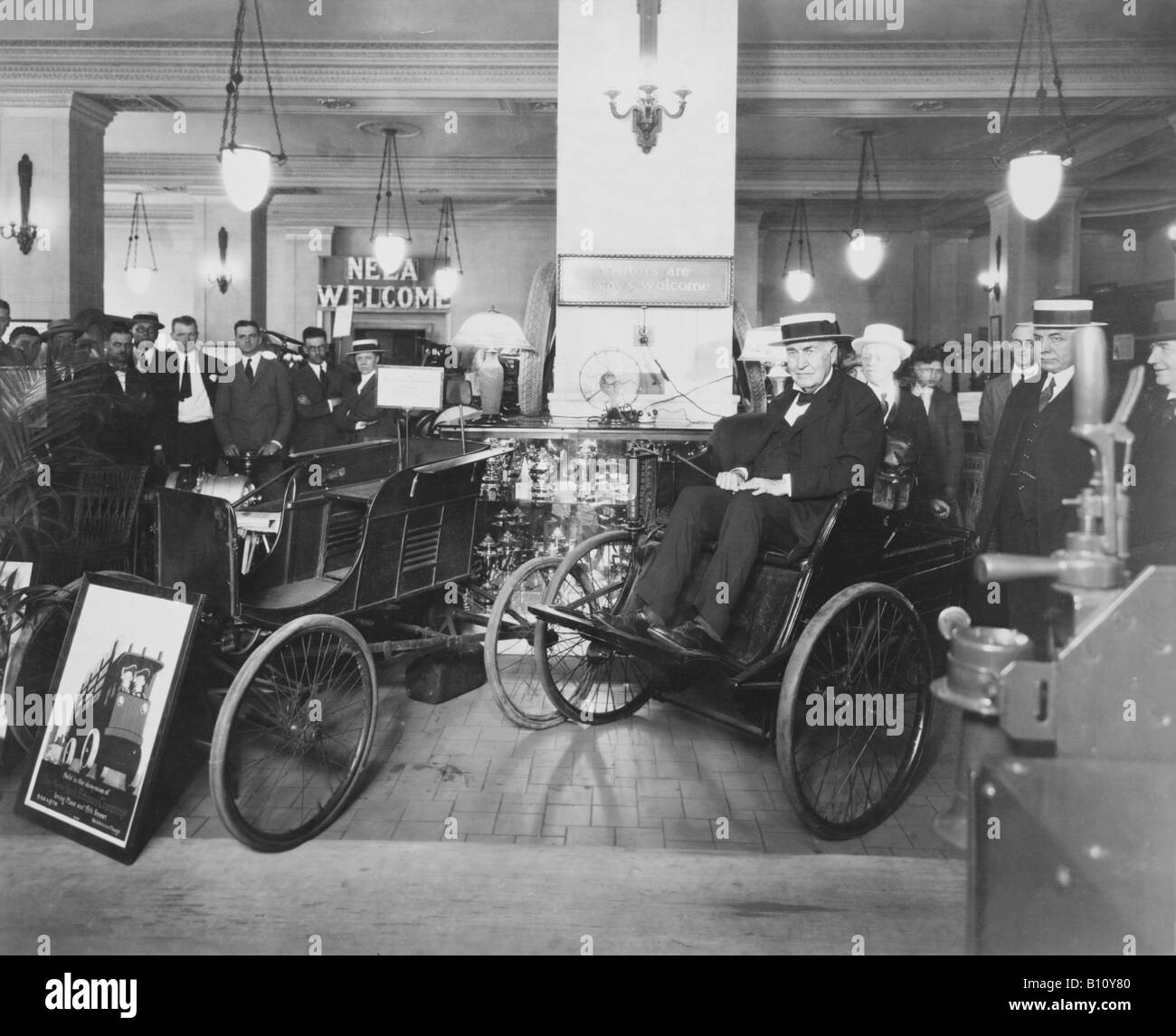 Thomas Edison sits in a quadricycle at the Consolidated Edison company which he founded. Invented by Henry Ford. - Stock Image