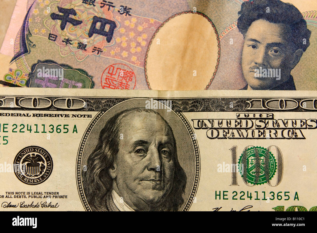 Japanese Yen and USD (American Dollar, United States Dollar) banknote money close up. - Stock Image