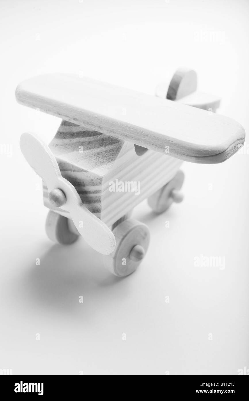 Black and white image of a wooden model aeroplane - Stock Image