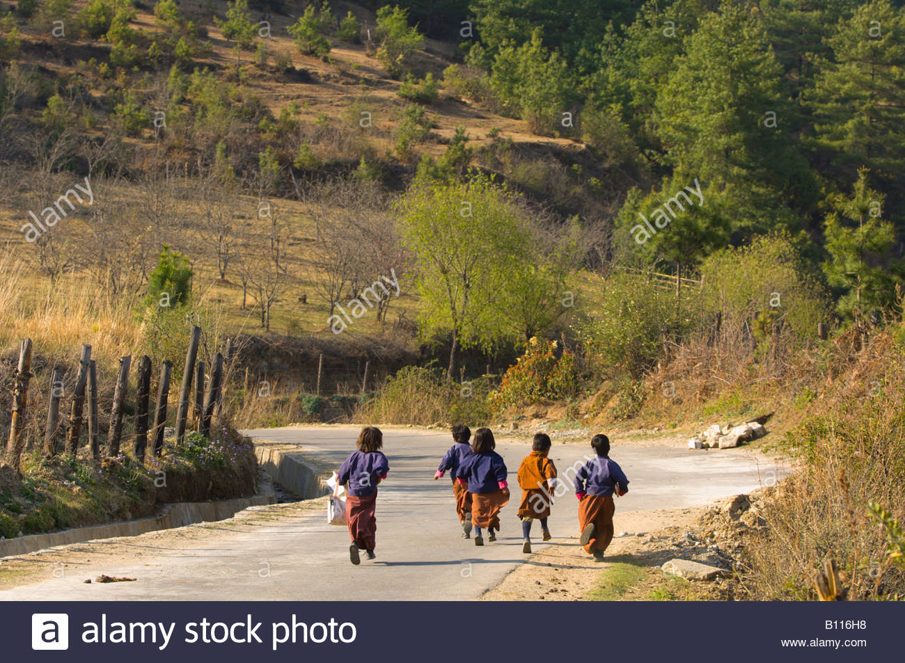 Paro Valley school children running in native costume, Bhutan - Stock Image