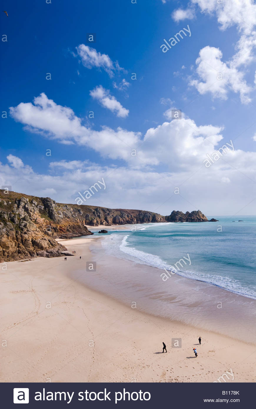 People on the beach at Porthcurno, West Cornwall, England. - Stock Image