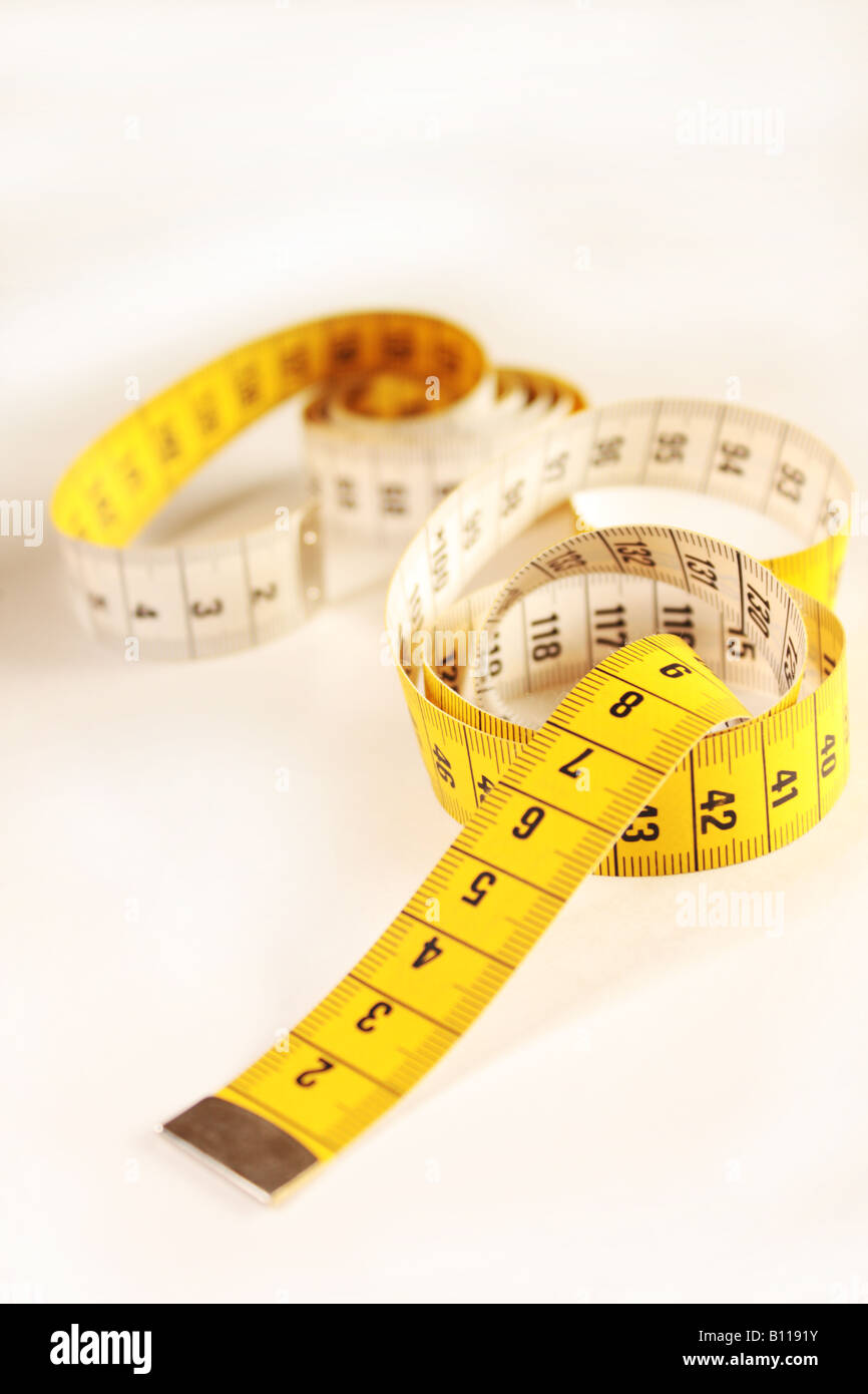 Close up of a yellow measuring tape - Stock Image