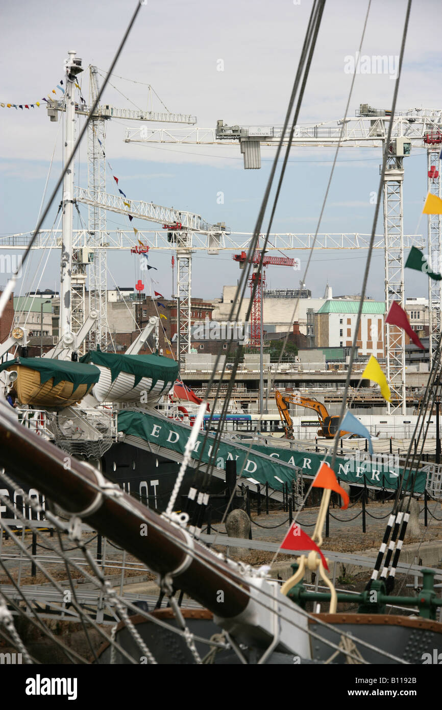 City of Liverpool, England. Various sail ships berthed at Albert Docks with building cranes in the background. - Stock Image