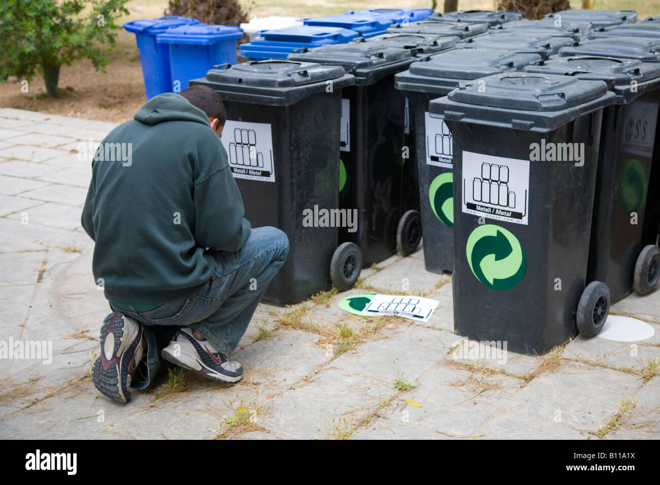 Several, many, stack of plastic metal recycling wheelie bins in Malta. Stock Photo