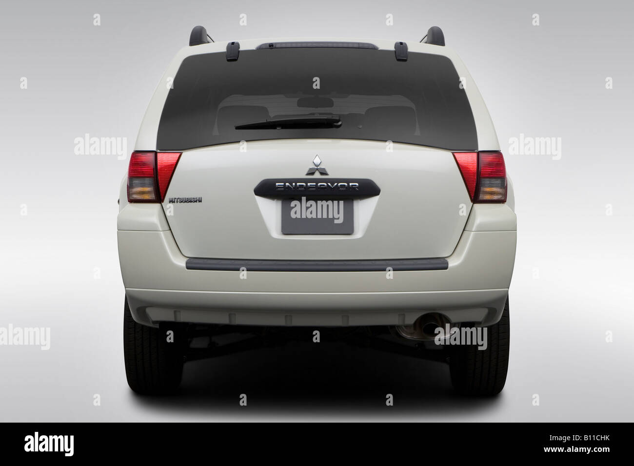 2008 Mitsubishi Endeavor Ls In White Low Wide Rear Stock Photo
