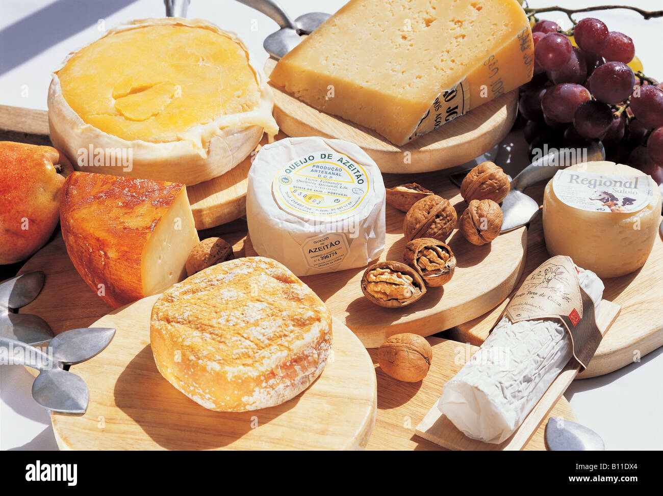 Cheese Selection and Fruit in Wood Cheeseboard Algarve Portugal - Stock Image