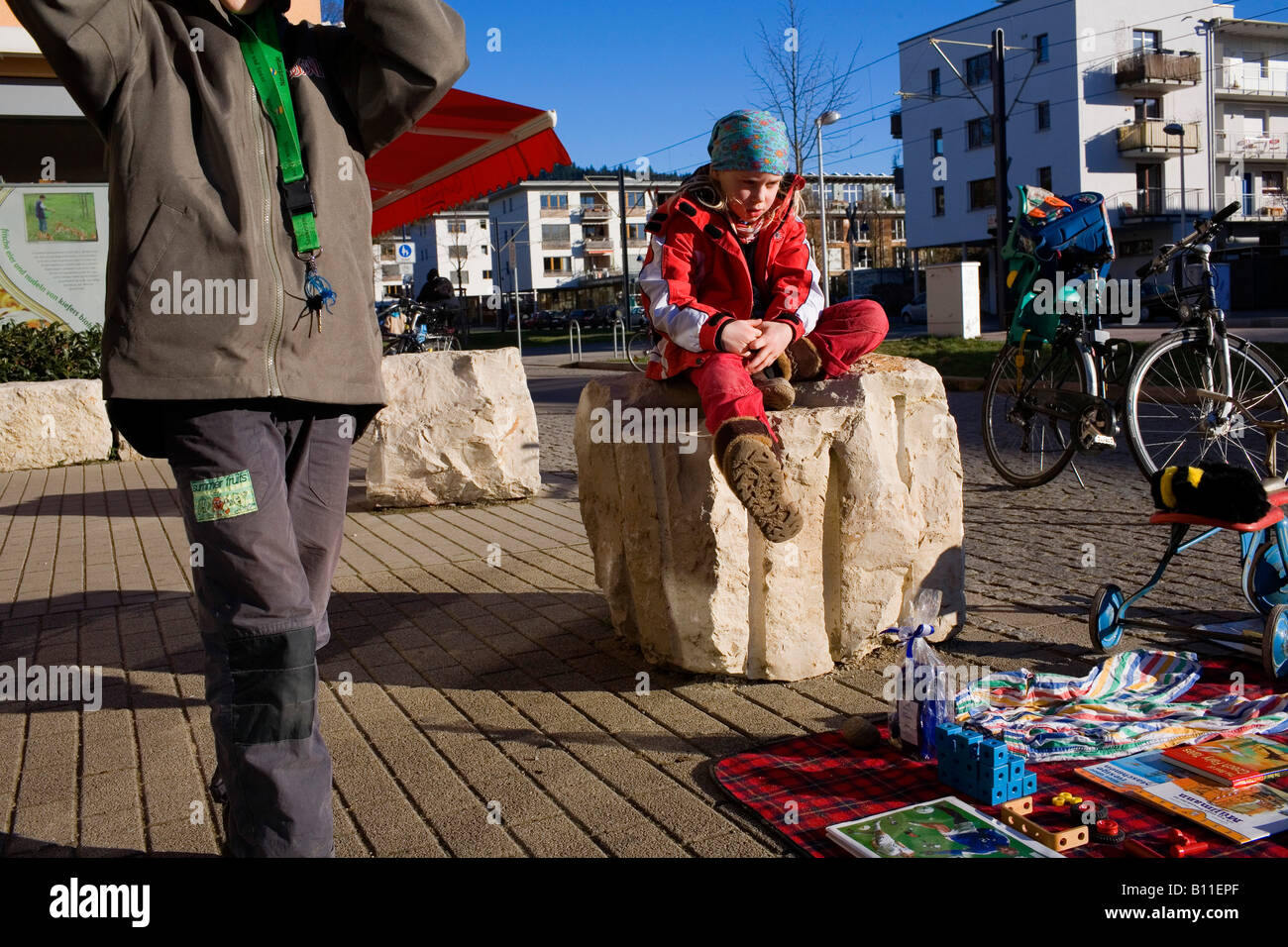 A jumble sale provides a focus on the street of the eco town Vauban - Stock Image