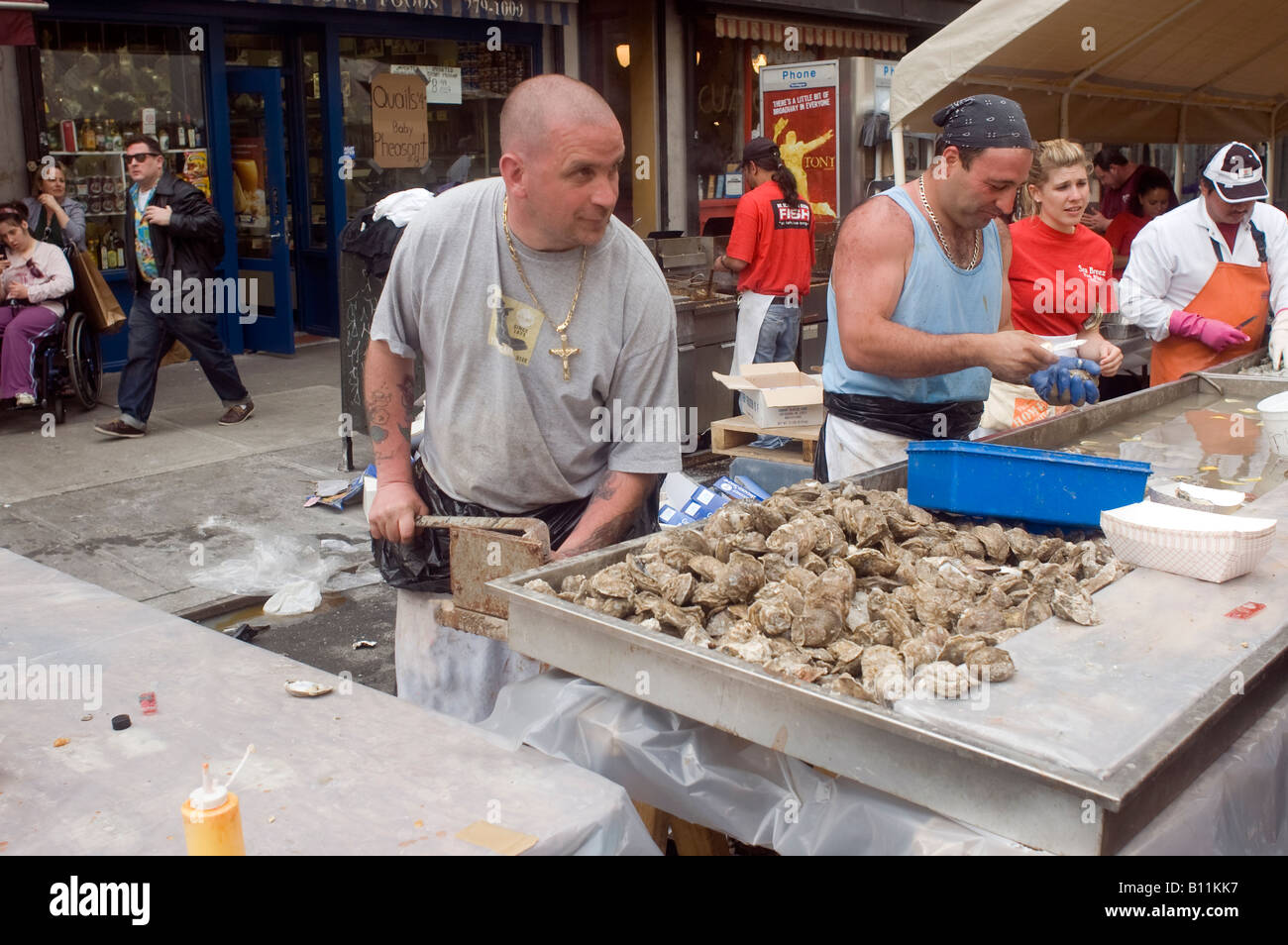 Oyster shucking at the famous Ninth Avenue Food Festival in New York - Stock Image