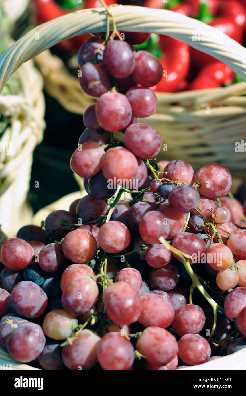 Black Grapes in a basket - Stock Image