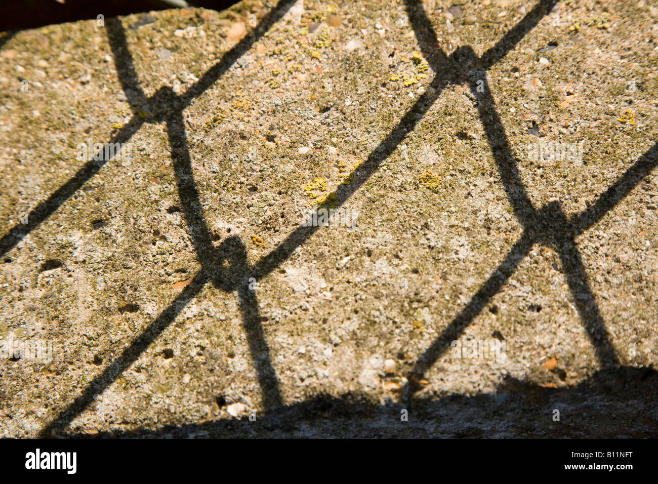 Shadow of chain-link fence - Stock Image