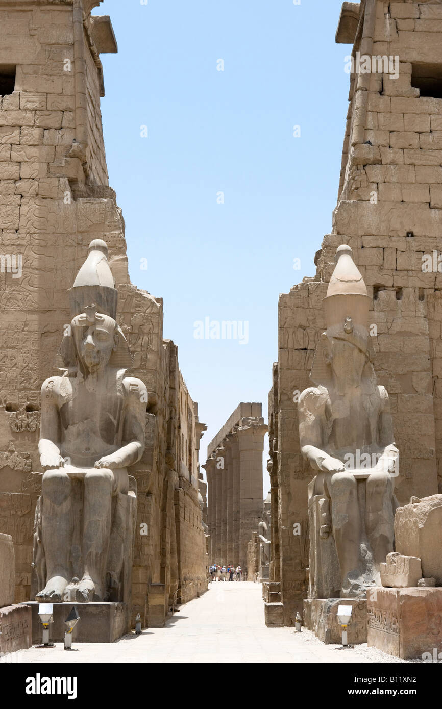 Colossi of Ramses II at the entrance to Luxor Temple, Luxor, Nile Valley, Egypt - Stock Image