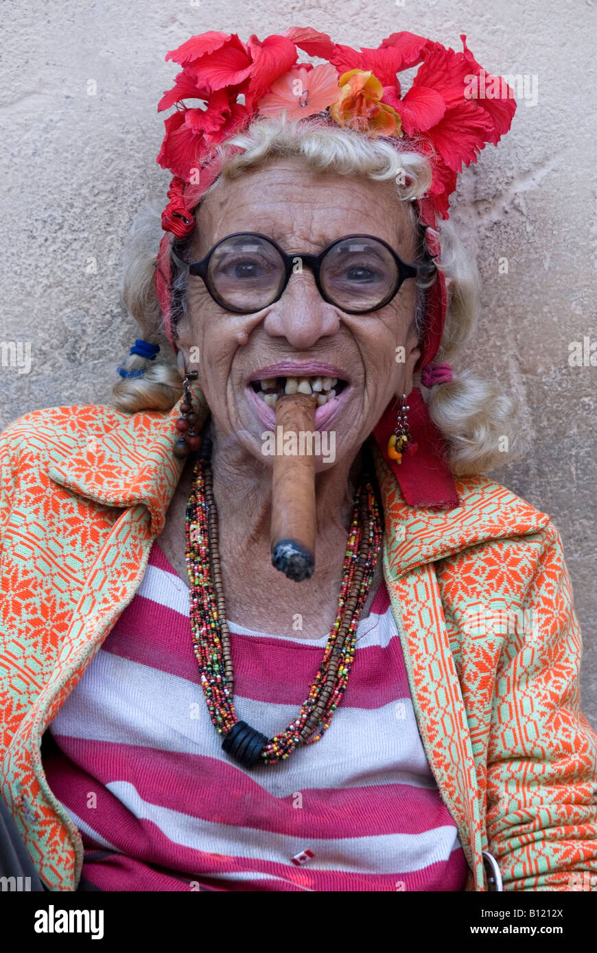 old lady smoking cigar in the old town area of havana cuba stock