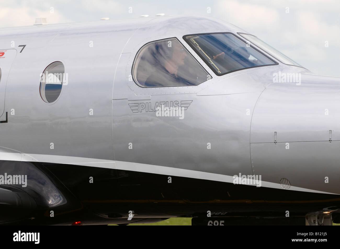 Pilatus PC-12 Duxford Spring Air Show 2008 Taxiing Pilot wearing Bose head phones - Stock Image