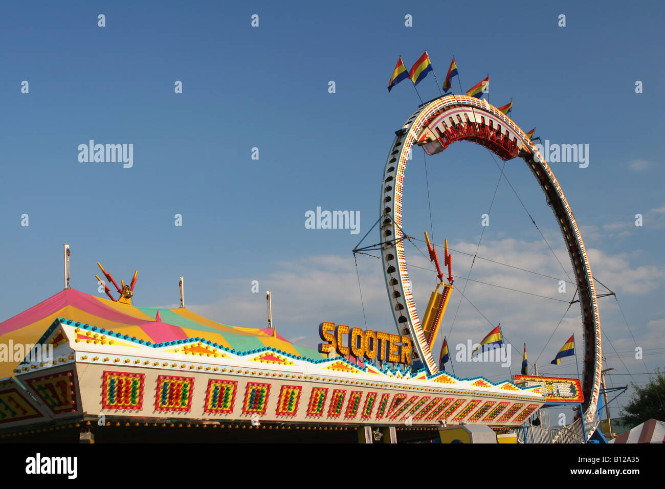 Carnival Rides named Scooter or Bumper Cars and Ring Of Fire beyond Canfield Fair Canfield Ohio Stock Photo