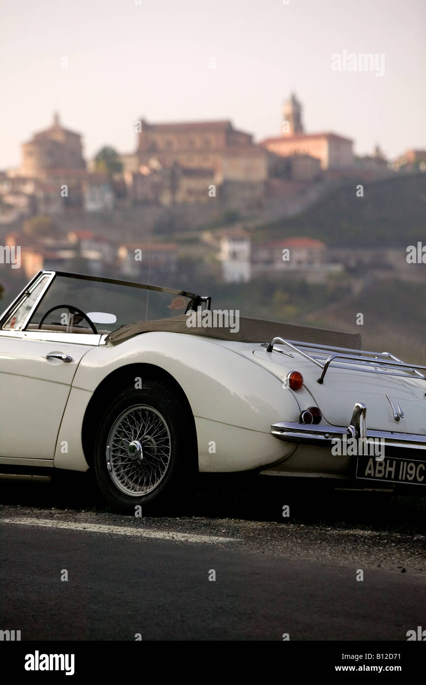 Sportscar Austin Healey parked on road near Italian village Barolo area of Italy 2008 - Stock Image