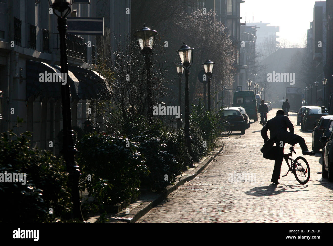 Man on a bicycle, in Amsterdam, The Netherlands, classic backlight image Stock Photo