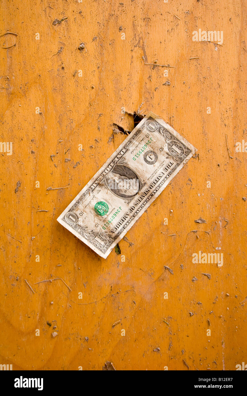 Dollar bill stuck to the door of a bathroom destroyed by a tornado in Aurora Nebraska USA. & Dollar bill stuck to the door of a bathroom destroyed by a tornado ...