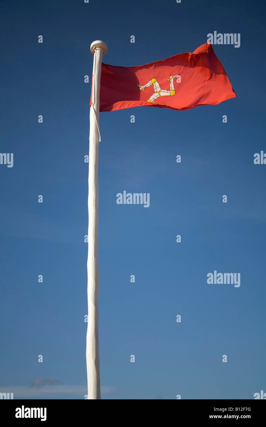 Isle of Man Flag, red with blue sky,flying on flagpole. vertical, 83108 IOM Flag Stock Photo