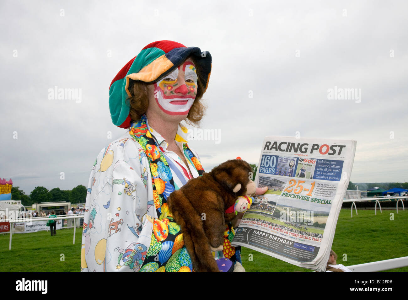 Horse racing event attended by Stevie (MR) the professional Clown and puppet at Corporate race meeting at Perth - Stock Image