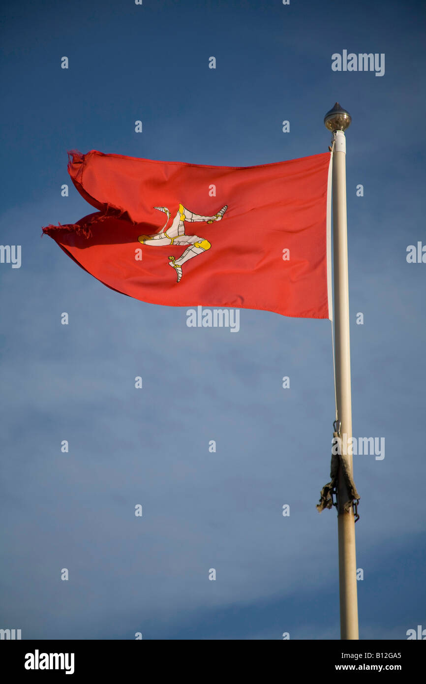 isle of man flag red with blue sky flying on flagpole vertical