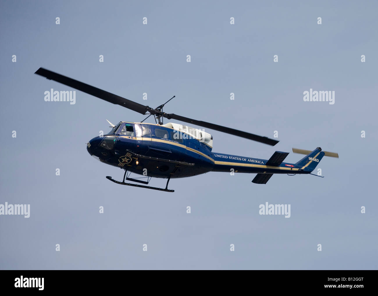 A dark blue United States government helicopter flies over Charlottesville Virginia on an overcast day on April - Stock Image