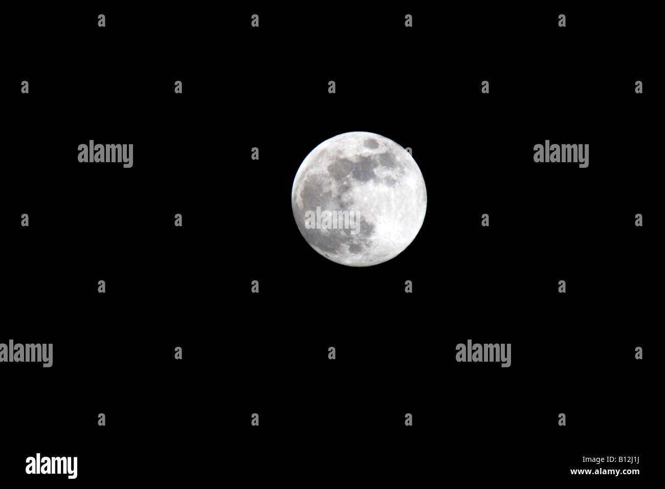 LARGE FULL MOON ON PLAIN BLACK SKY - Stock Image