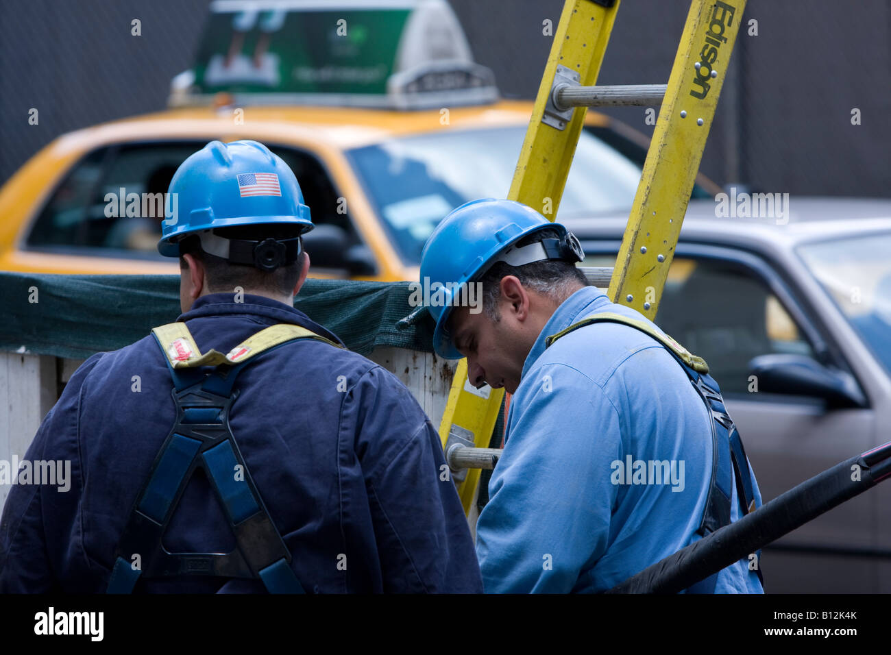 Two Con Edison workers in Manhattan NY. - Stock Image