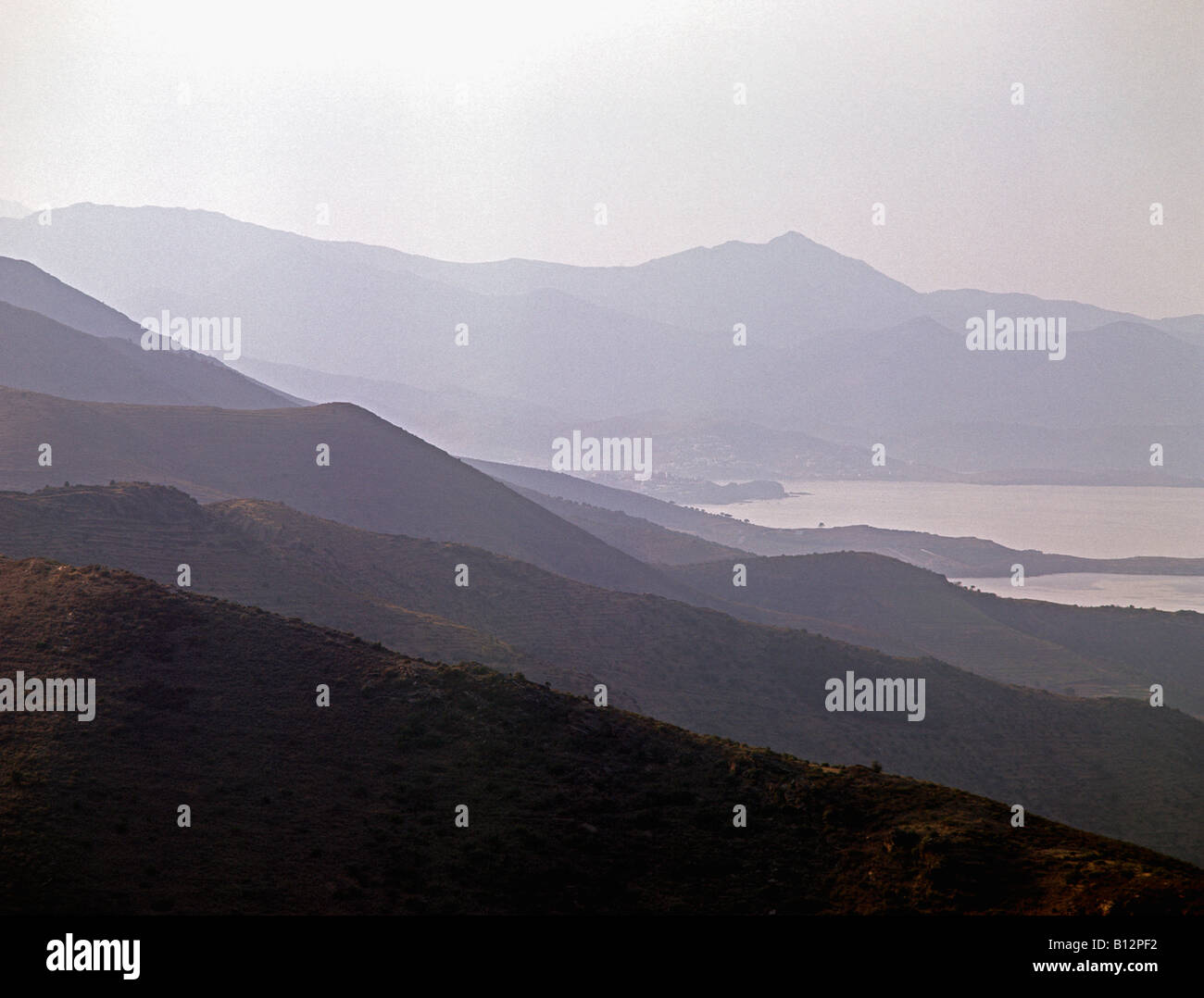 foothills of The Pyrenees slope down to the Mediterranean from the Spanish side of the border with France - Stock Image