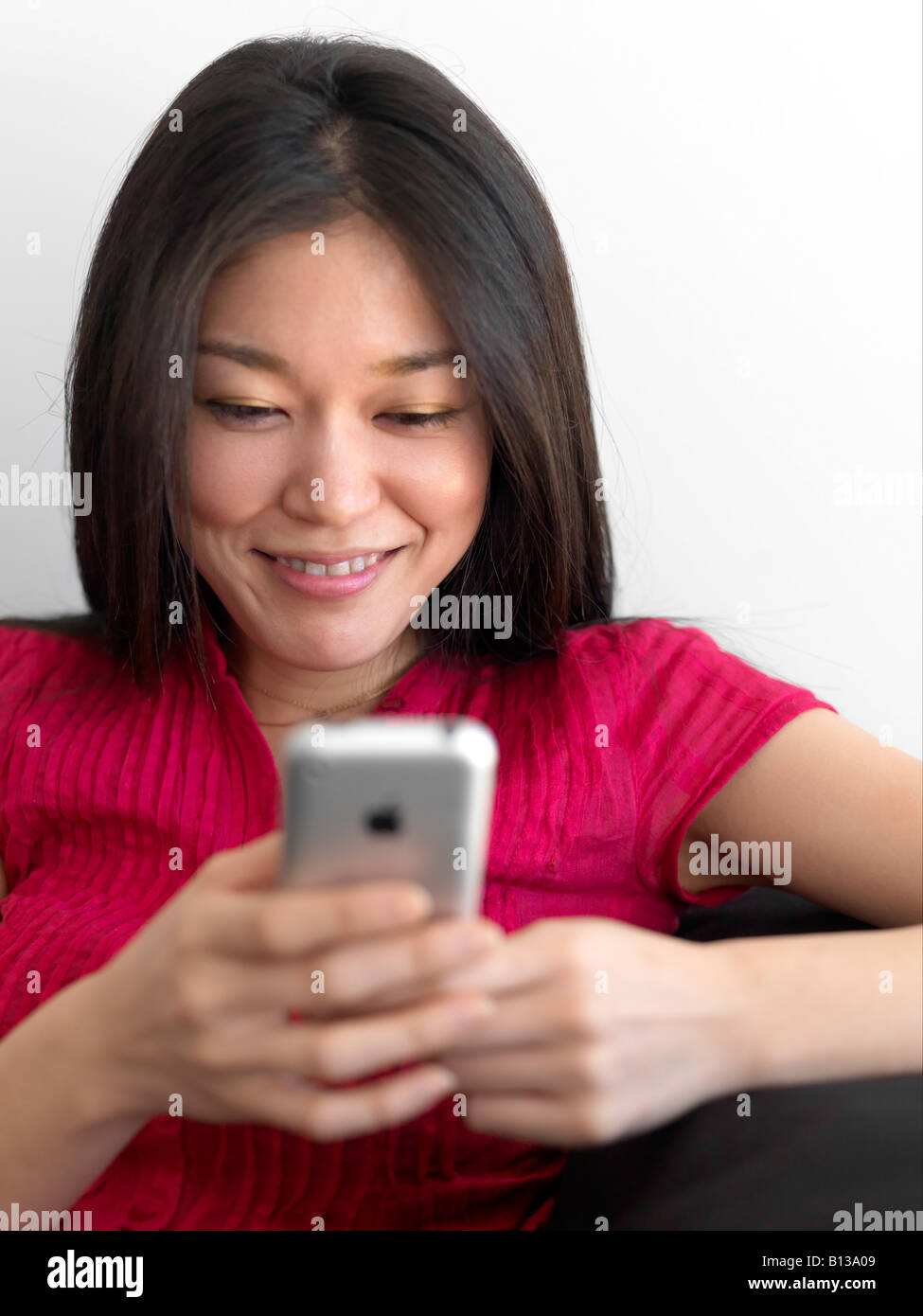 Young Asian women using mobile phone. - Stock Image