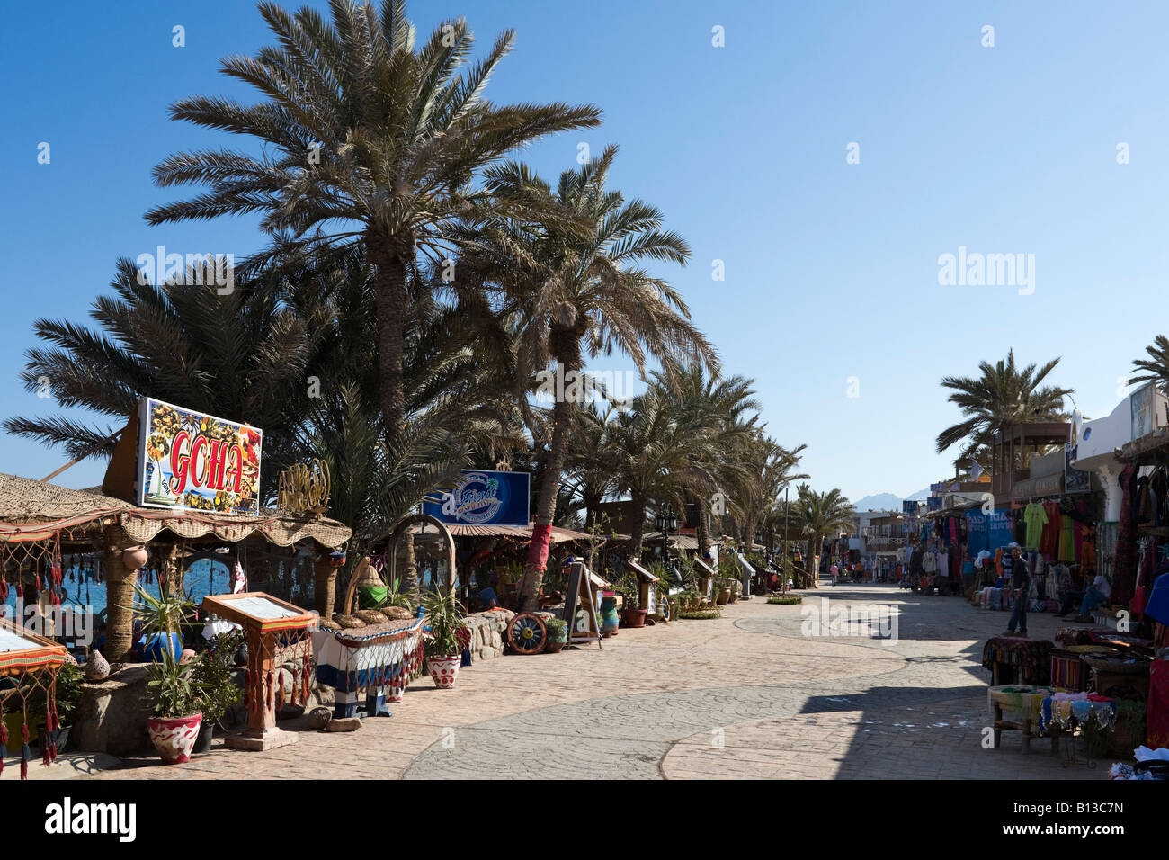 Shops and restaurants on Masbat seafront in Asilah, Dahab, Gulf of Aqaba, South Sinai, Red Sea Coast, Egypt - Stock Image