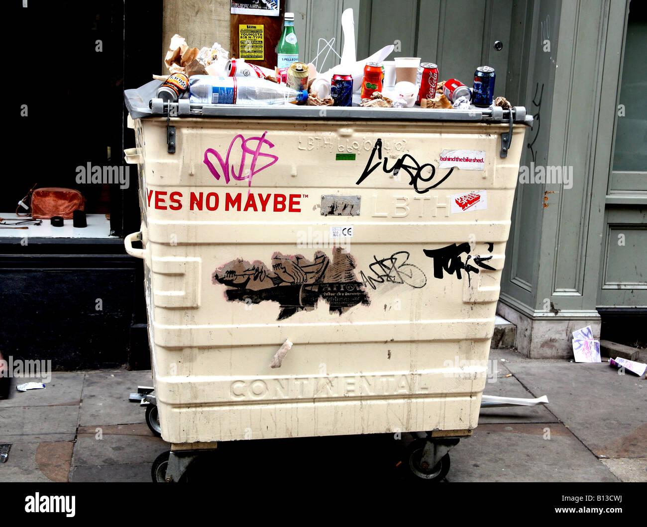 Rubbish placed on top of bin in London street Stock Photo