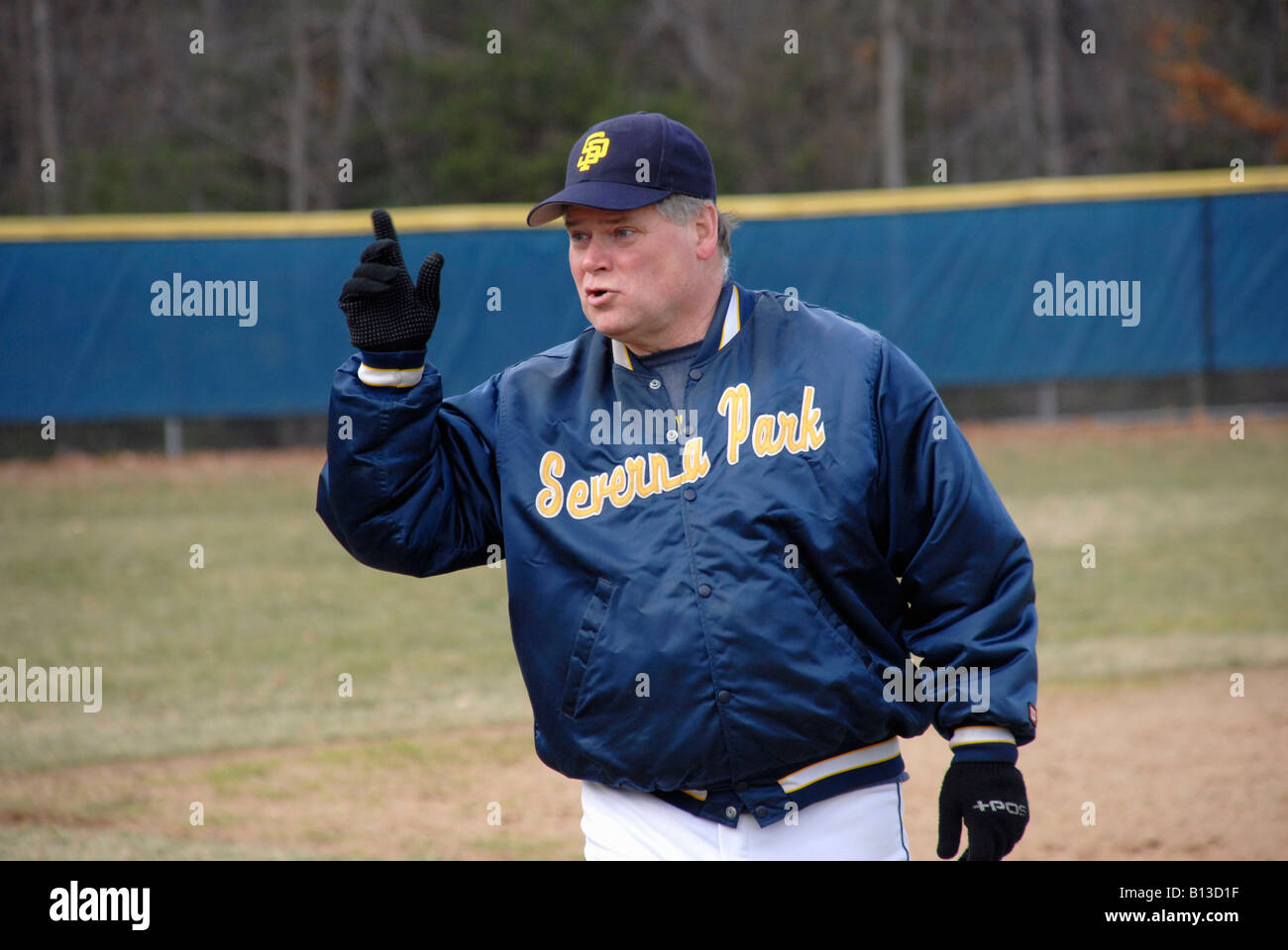 baseball coach given instruction to a batter in a high school baseball game in Severna Park, Maryland - Stock Image