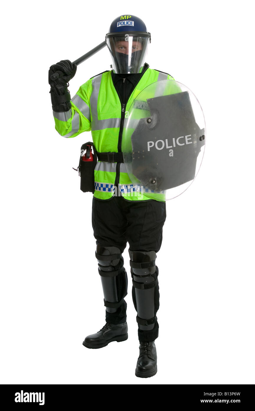 Metropolitan police officer in full riot gear with shield and baton raised on a white background - Stock Image