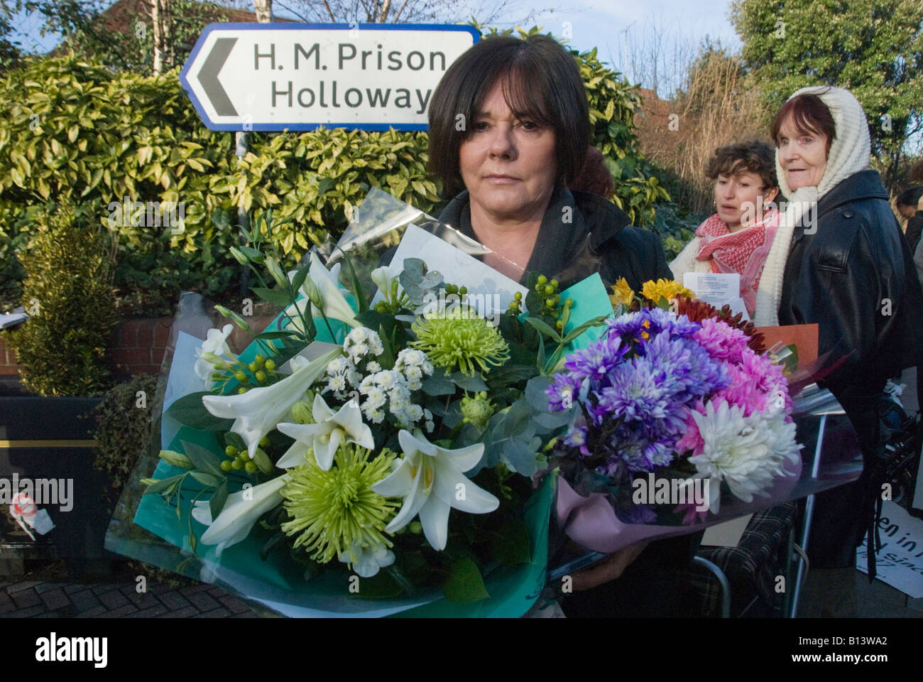 Demonstrators with wreaths outside H M Prison Holloway mourn the death of Jaime Pearce and protest against continuing - Stock Image