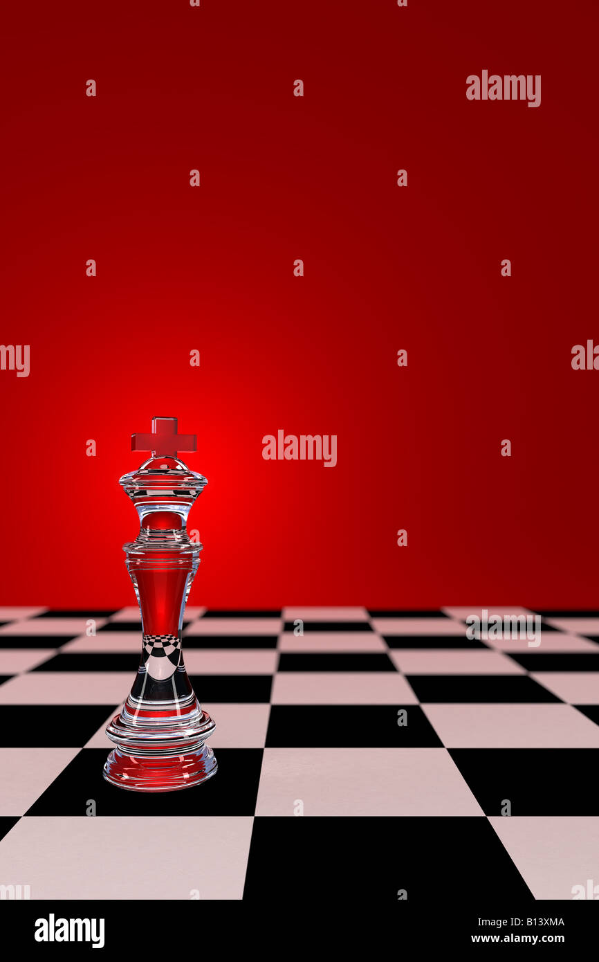 Glass Chess King on checkerboard with low depth of field - Stock Image