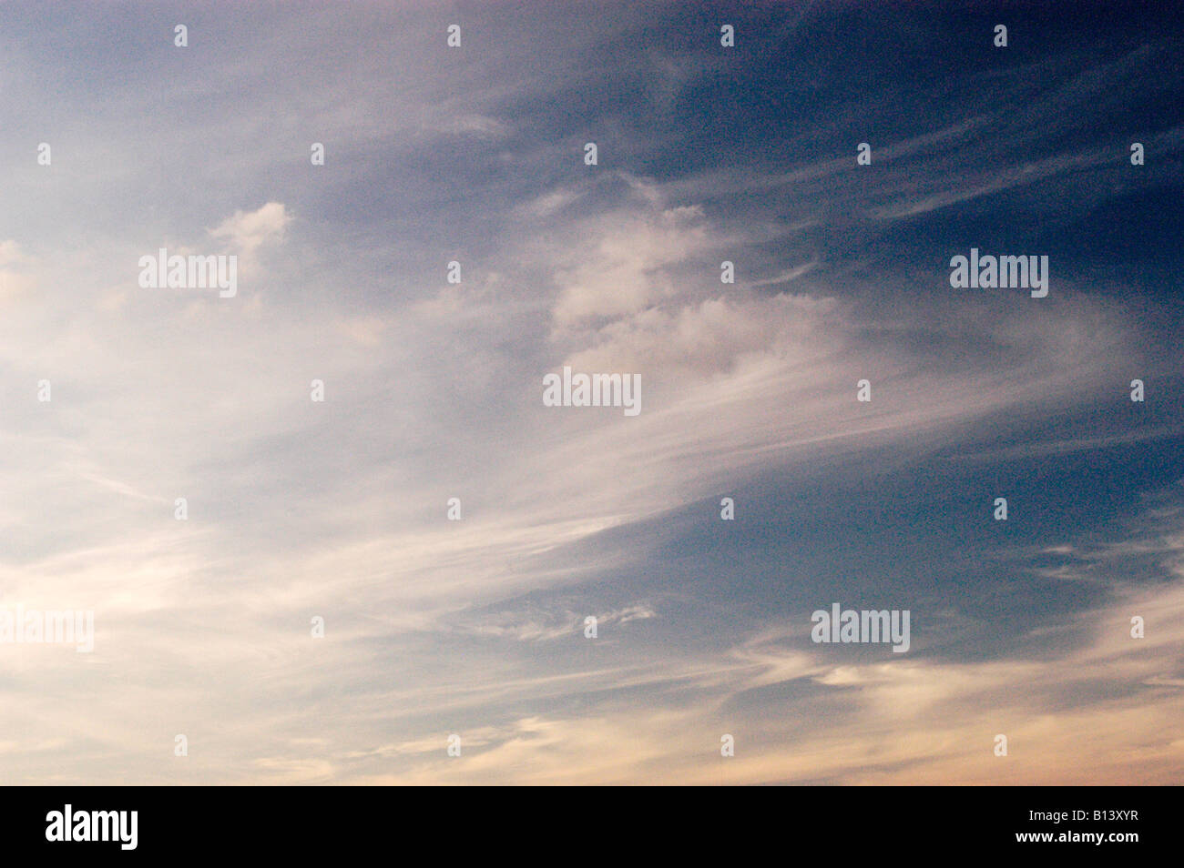 CIRRUS CLOUDS IN EVENING SKY - Stock Image