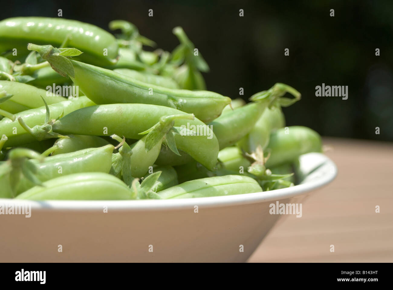 a heaping bowl of pea pods fresh from the farmer s market stock