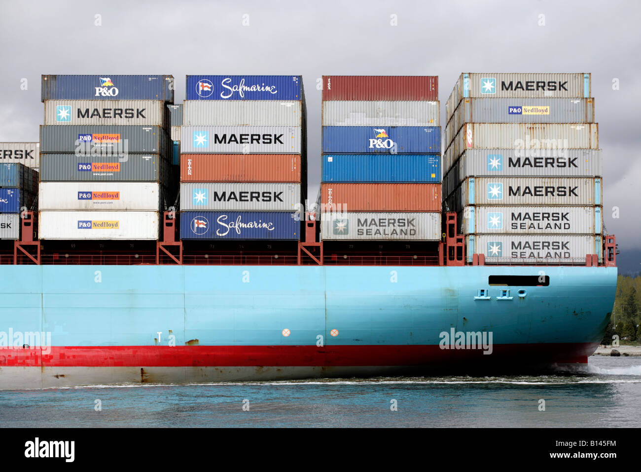 Maersk container ship leaving Vancouver port. (The Sofie Maersk, registered in Copenhagen) - Stock Image