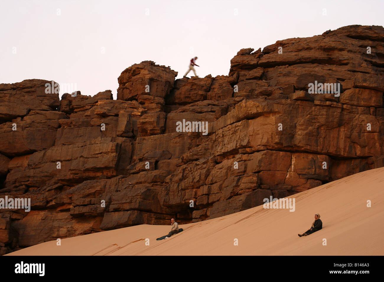 Tourists enjoying in Oued Tin Tarabine Tassili Ahaggar at sunset Algeria - Stock Image