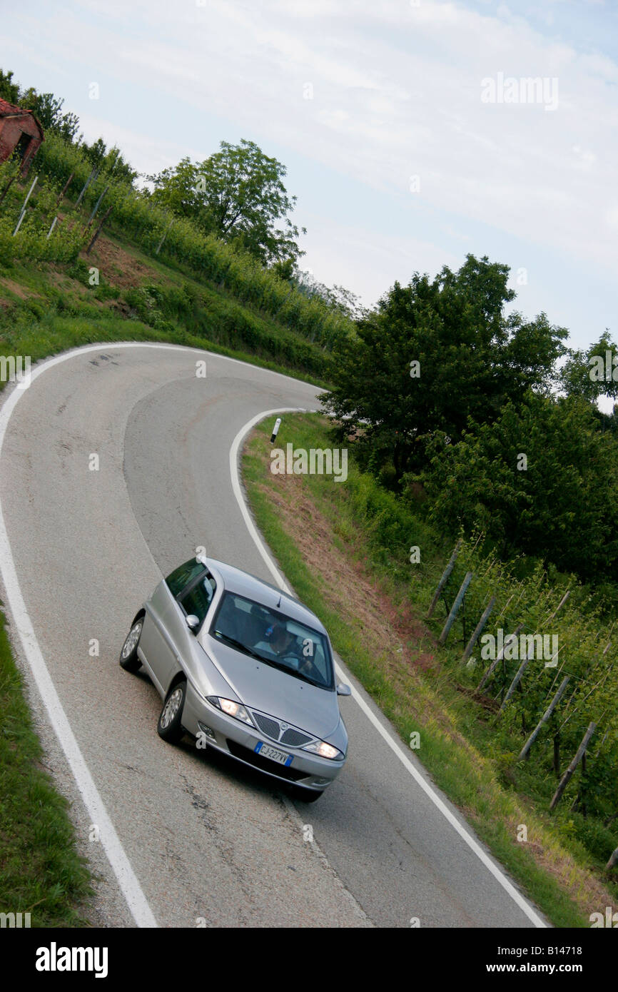 Lancia Y in a rural road. - Stock Image