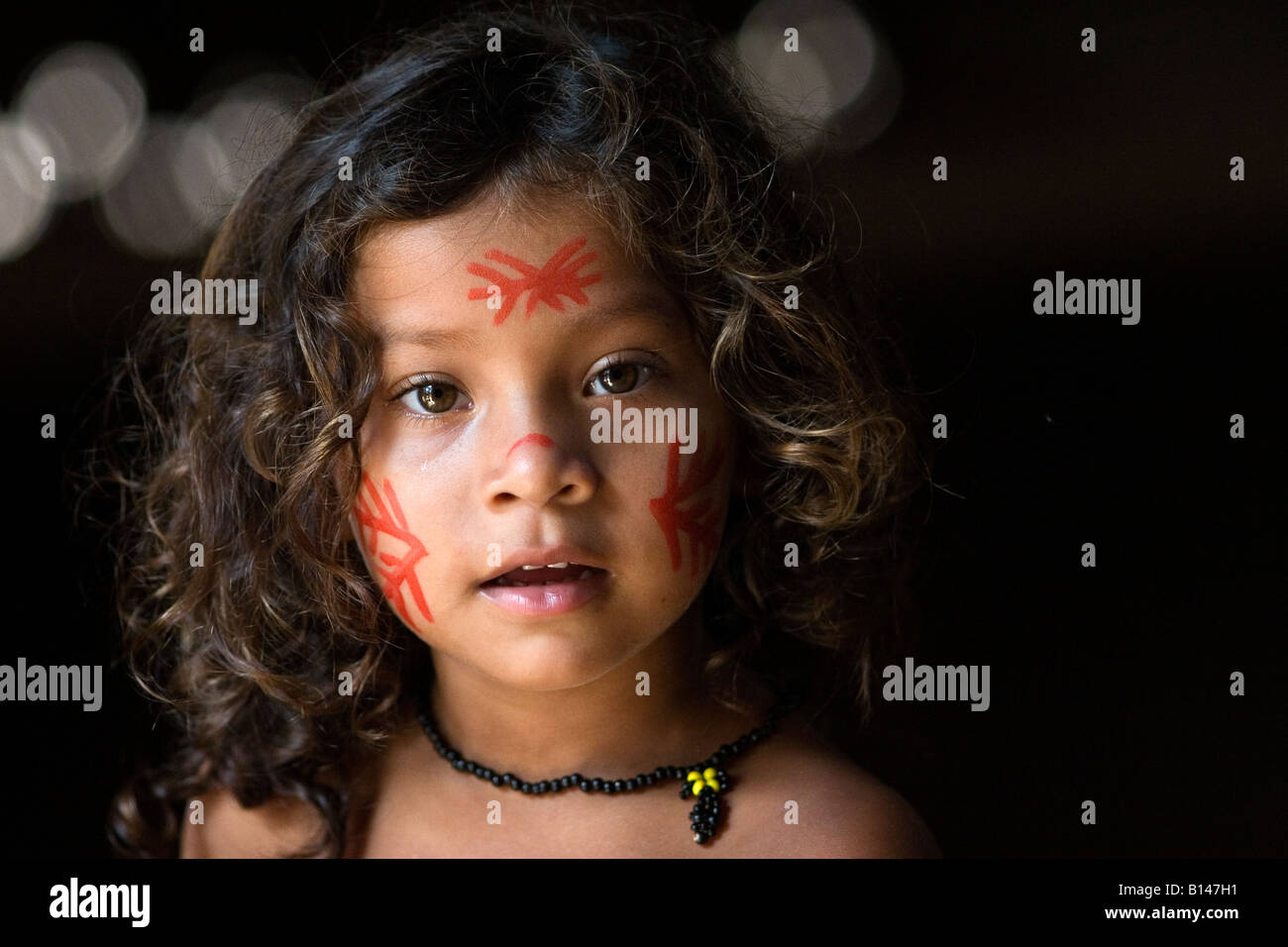 A young girl from the Tucanos tribe. - Stock Image