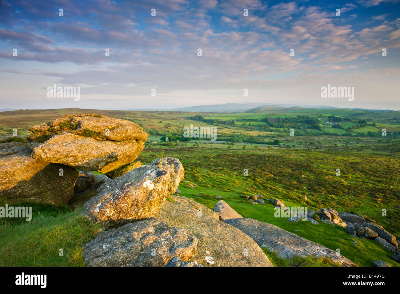 Moorland and fields of Dartmoor viewed from Saddle Tor Dartmoor National Park Devon England - Stock Image