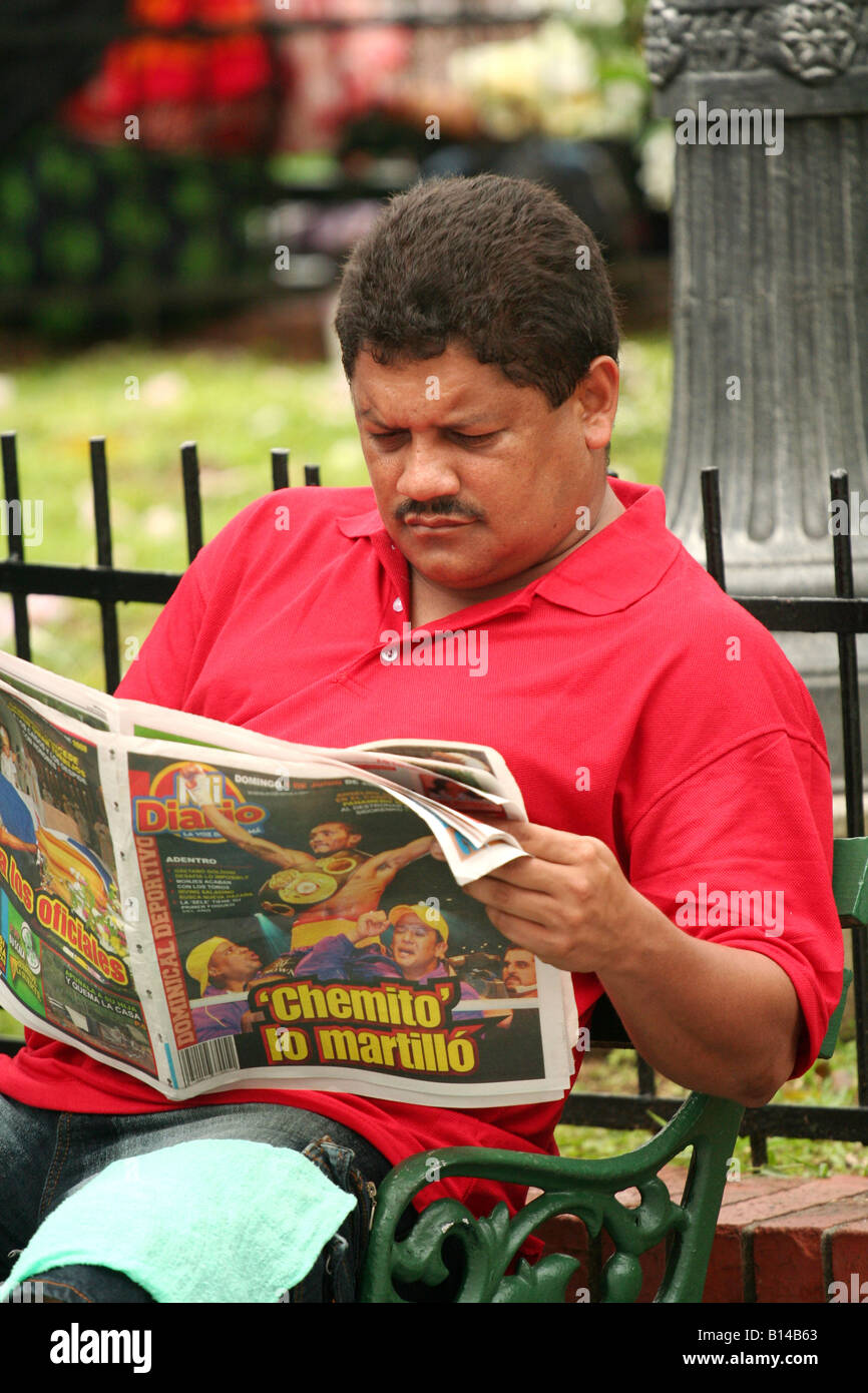 Panamanian male readin his newspaper in a street of Panama City. For Editorial Use Only Stock Photo