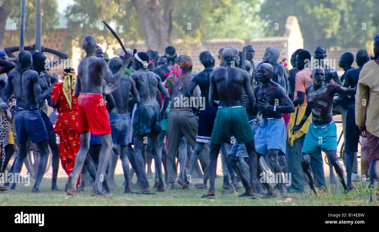 Every Dinka male is a warrior.  These young men group at an annual gathering to select a new song for their warrior - Stock Image