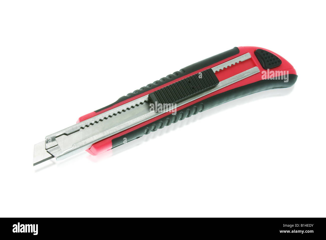 Red utility knife isolated on white background - Stock Image