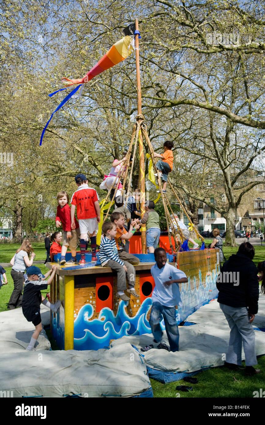children playing pirates ship park summer - Stock Image