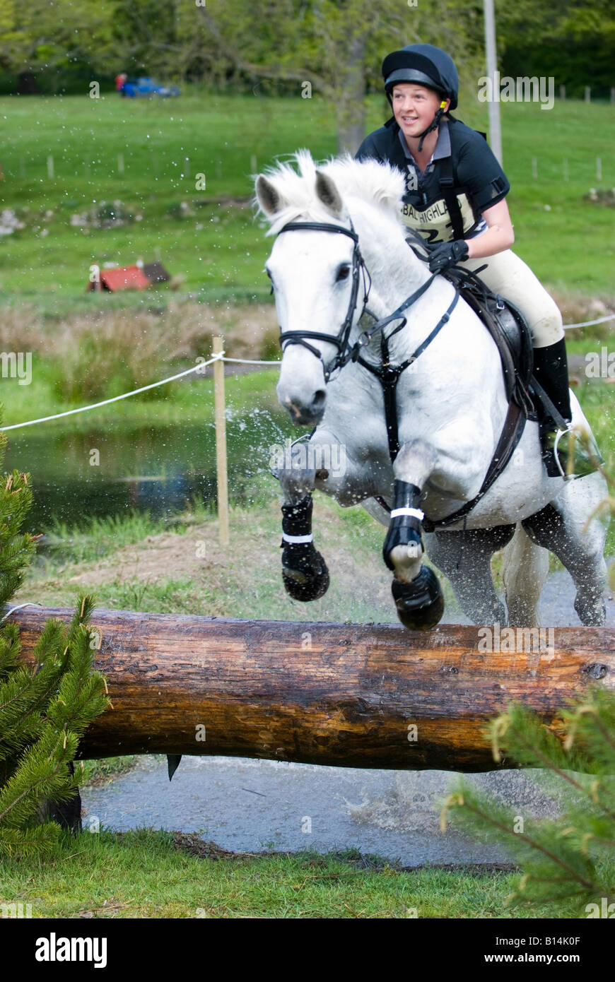 Hilary Ross jumping with Jasmine V at Scotsburn Horse Trials - Stock Image