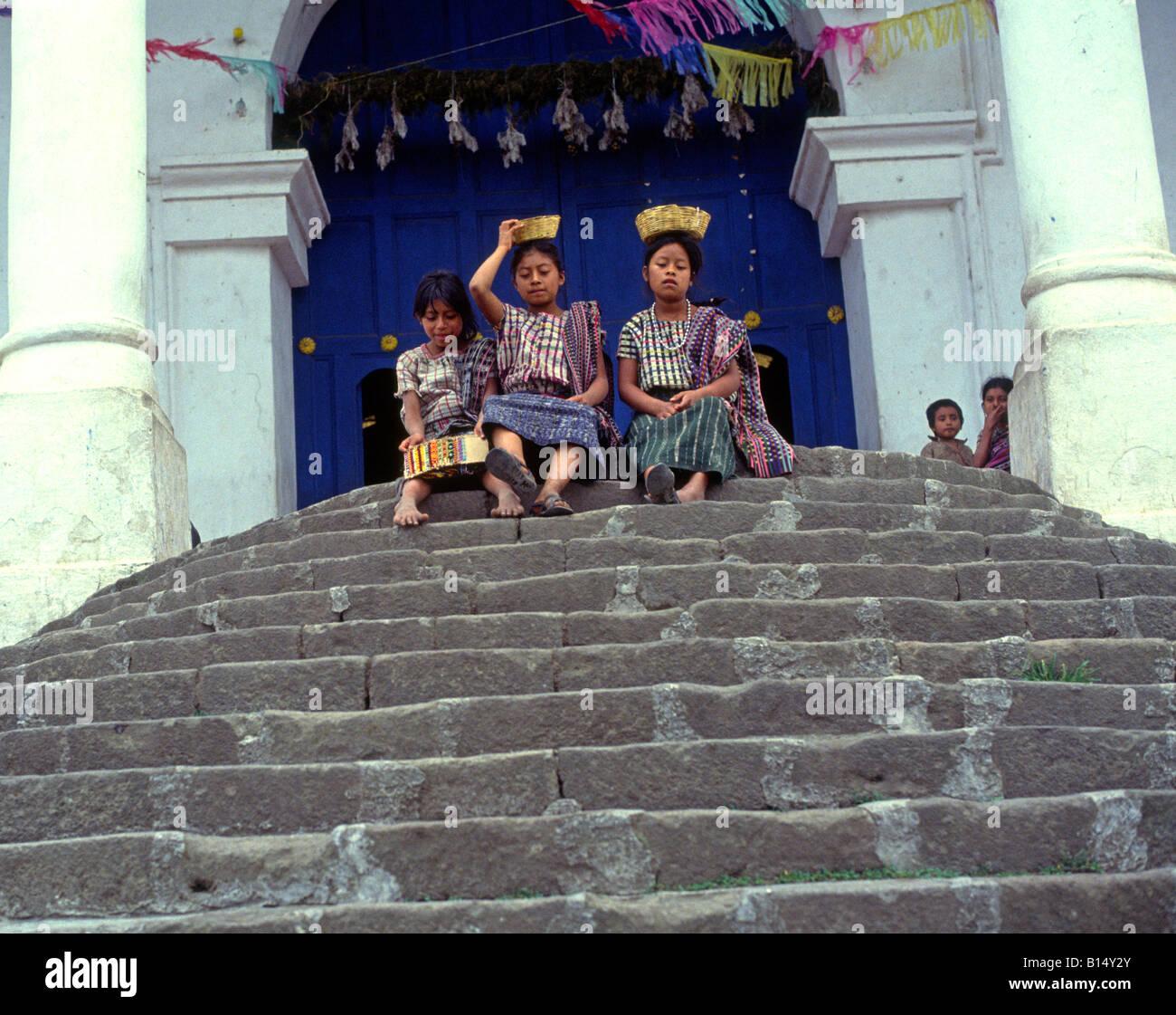 Mayan children sitting on church steps Santiago Atitlan, Guatemala - Stock Image