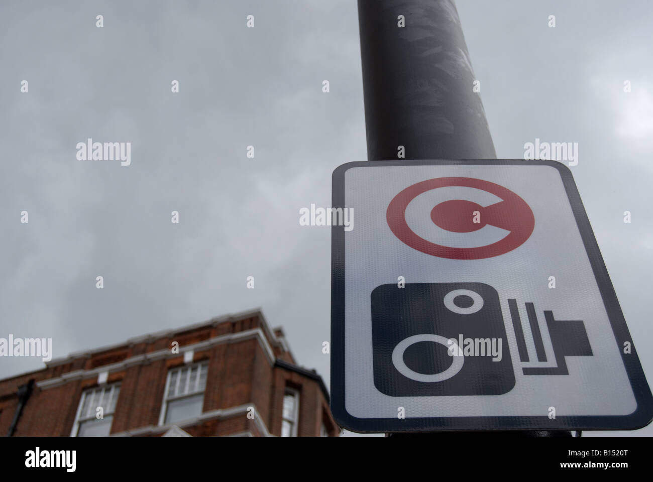 sign for london congestion charge with warning of camera , in chelsea, west london, england - Stock Image