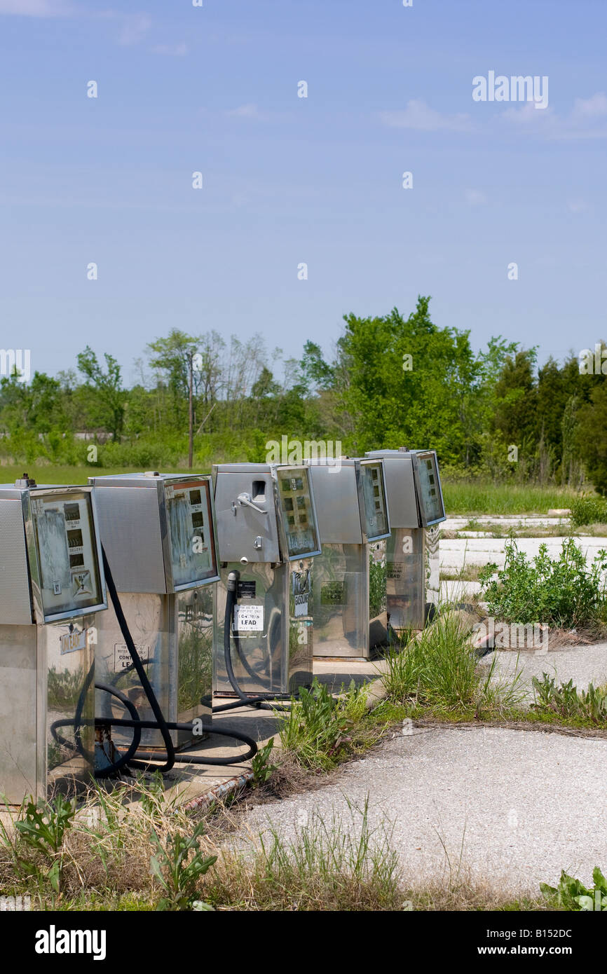 Abandoned gasoline pumps along a highway, USA. - Stock Image